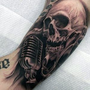 05-scary-skull-singing-tatto-for-guys